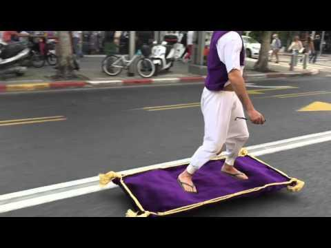 Guy Rides Magic Carpet Down Street