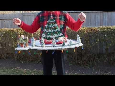 The World's Ugliest Christmas Sweater Includes A Working Toy Train Set