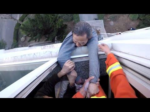 Firefighter Saves Man From Falling Out Window Video