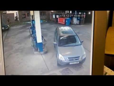 Hilarious! - Camera Captures Lady's Confusion At Gas Pump