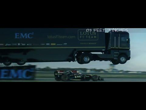Tractor Trailer Jumps Over Lotus F1 Race Car