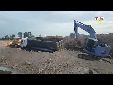 Truck stuck in mud recovery by Excavator