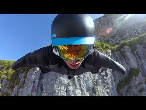 Majestic Wingsuit Flying In Switzerland