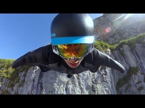 Majestic Wingsuit Flying In Switzerland