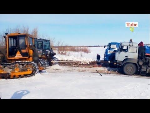 Heavy Machines Recovery - Bulldozer pulling truck stuck in mud