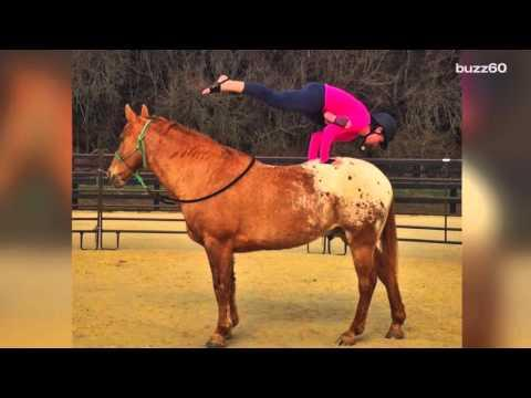 Woman Does Downward Dog On Top Of Her Horse