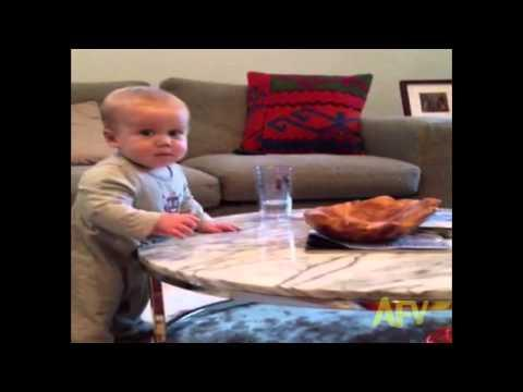 Baby Can't Resist Knocking Over Glass