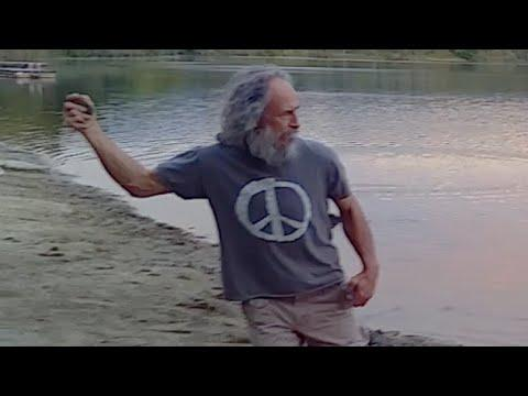 Old Hippy Skipping A Stone