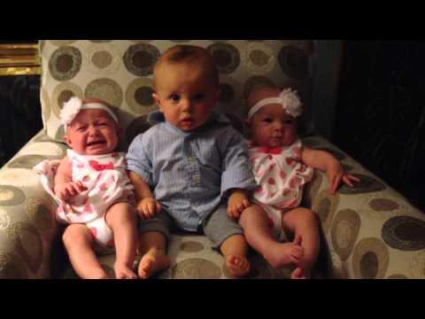 This Baby In Between Identical Twins Is BEYOND Confused