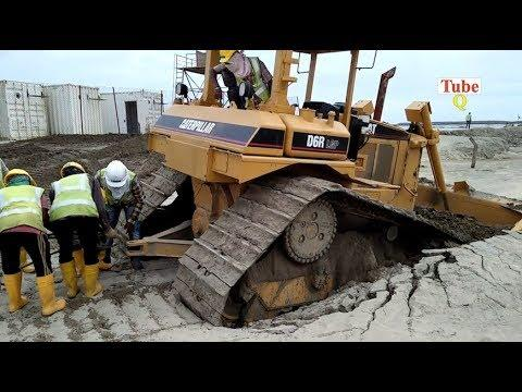The biggest Dozer stuck in mud in the world
