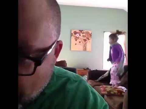 Exhausted Dad Drinks Coffee While Young Daughter Dances